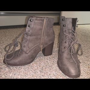 Comfortable heeled boots, with strap up detail.
